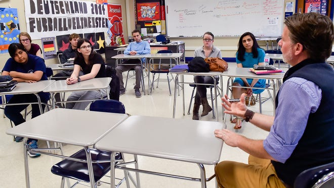 Students in an AP German class at Chambersburg Area Senior High school listen and converse with their teacher, Paul Unhur, in German about a movie on Wednesday May 18, 2016. The students took the AP German test May 6. A portion of the AP German test requires students to converse in German.