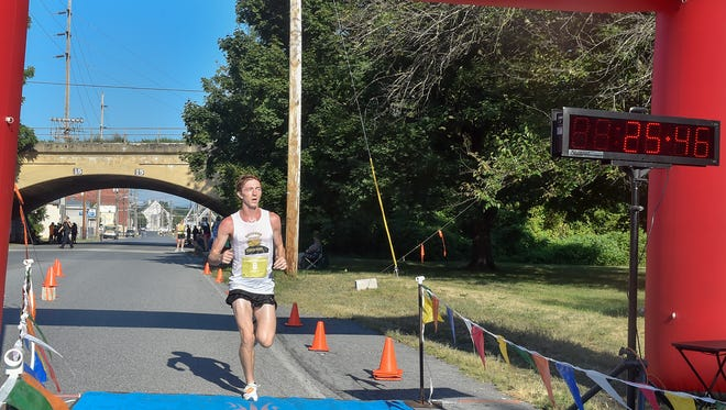 Dylan Mountain of Altoona wins the Ausherman 5-mile race on Saturday, August 13.