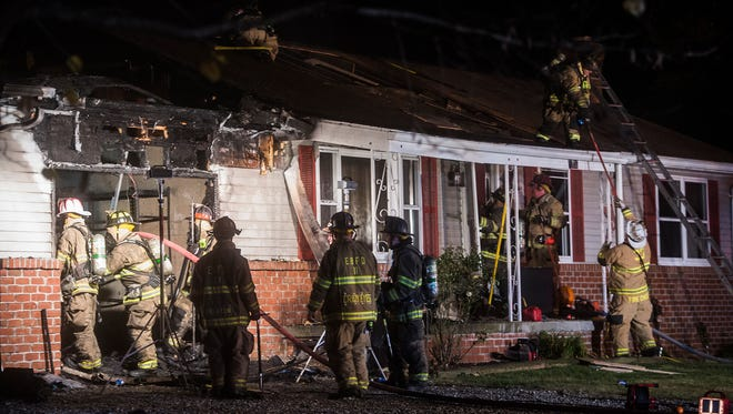 Firefighters work at the scene of a house fire in the 5600 block of Carlisle Pike in Reading Township on Nov. 2, 2016.