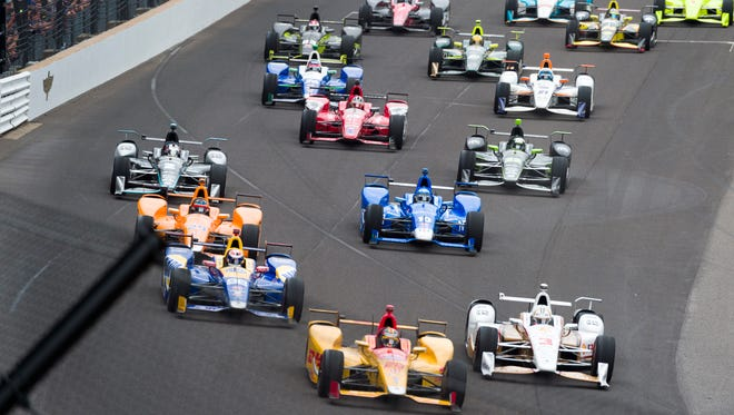 Cars heading into turn one during the running of the 101st Indianapolis 500, at Indianapolis Motor Speedway, Sunday, May 28, 2017.
