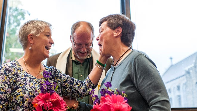 Cathy McGaughey, left, and Diane Ansley celebrate during their marriage ceremony at the Buncombe County Register of Deeds office in Asheville. The Campaign for Southern Equality called on the U.S. Supreme Court to rule quickly on same-sex marriage given recent developments in Alabama. The Southern state, which became the 37th U.S. state to allow gay marriages, recently ordered probate judges to stop issuing licenses, saying the state retains authority over Alabama law, not a federal trial judge.