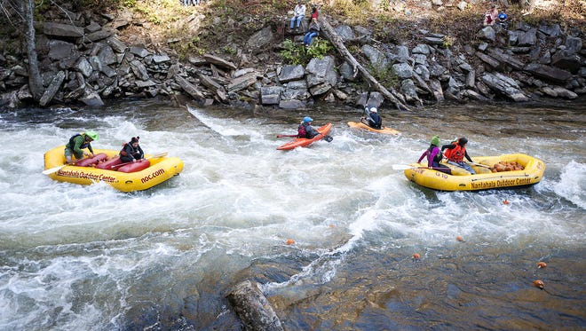 """Boaters in the Nantahala River, the site of an """"in-stream"""" whitewater park similar to what advocates want to build on the French Broad River in Asheville."""
