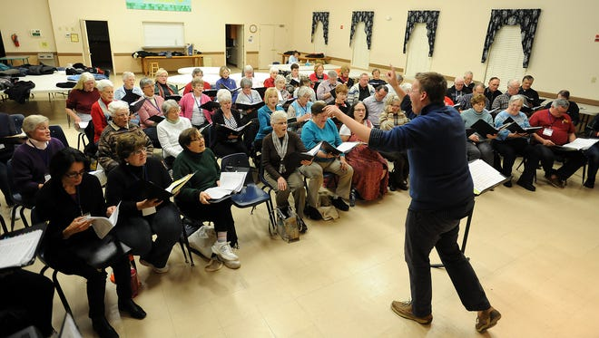 Conductor Joseph Shortall instructs the Southern Delaware Chorale Society as it practices for upcoming holiday concerts at Georgetown Presbyterian Church.