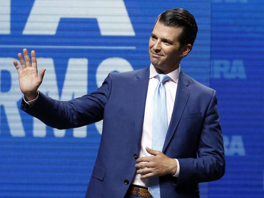 In this May 4, 2018, file photo, Donald Trump Jr., waves from the stage at the National Rifle Association in Dallas.