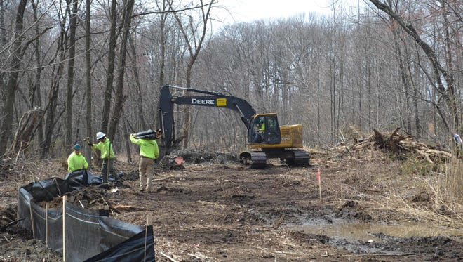 Crews working on March 25 to prepare the former South River Metals site for remediation. The former industrial site is set to become a $44-million affordable housing development.
