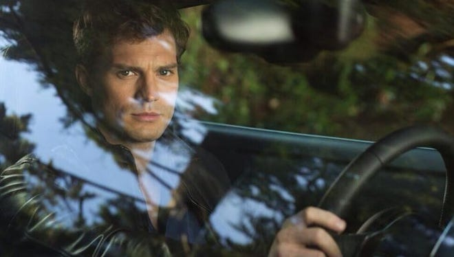 """Jamie Dornan as Christian Grey in a scene from """"Fifty Shades of Grey."""""""