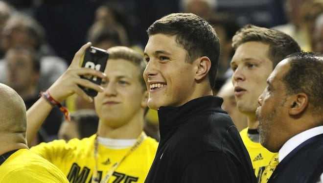 Zach Gentry watches Michigan's game against Wisconsin on Saturday night.