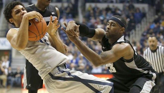 Dee Davis (left) and Xavier are aiming to curb their road woes when they play at Marquette, Tuesday at 9:15 p.m. XU is 1-5 on the road in Big East play.