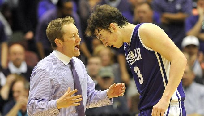 Furman head basketball coach Niko Medved talks with forward Geoff Beans (3) during a timeout during the 2015 Southern Conference men's basketball championship at the U.S. Cellular Center in Asheville on Monday.