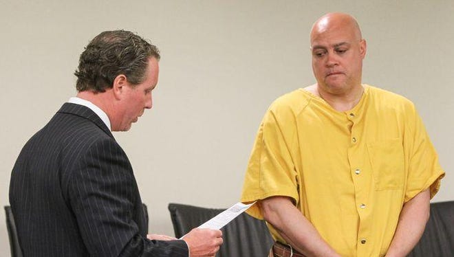 Freehold, NJ (L) Marc LeMieux 1st assistant prosecutor for Monmouth County reads the charges against Philip Seidle, a Neptune police officer charged with the murder of his wife Tamara in Asbury Park. Seidle, while off duty, shot his wife multiple times killing her.
