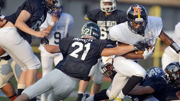 McQuaid's Amari Lawrence scored on a 35-yard run during the 2015 Eddie Meath All-Star High School Football Game at East Irondequoit Eastridge