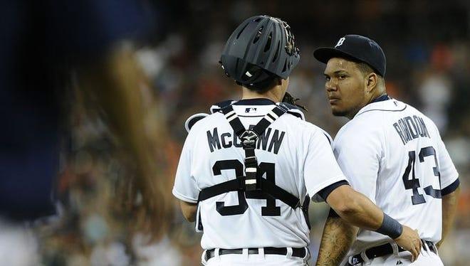 James McCann talks to Bruce Rondon during Saturday night's loss.