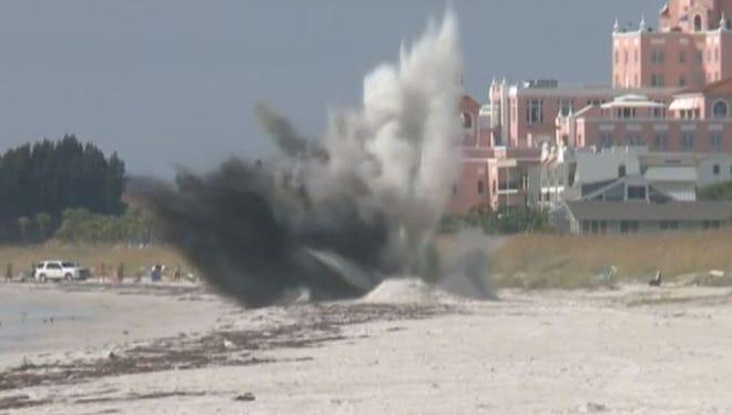 A World War II-era bomb is detonated on a beach near Tampa, Fla.