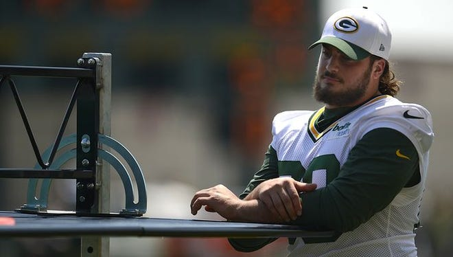 Green Bay Packers left tackle David Bakhtiari looks on during training camp practice at Ray Nitschke Field on Saturday, Aug. 15, 2015.