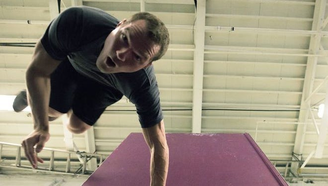 """Justin Gielski of Medford Lakes practices a """"wall spin"""" inside Pinnacle Parkour Academy Tuesday, July 7 in Cherry Hill."""