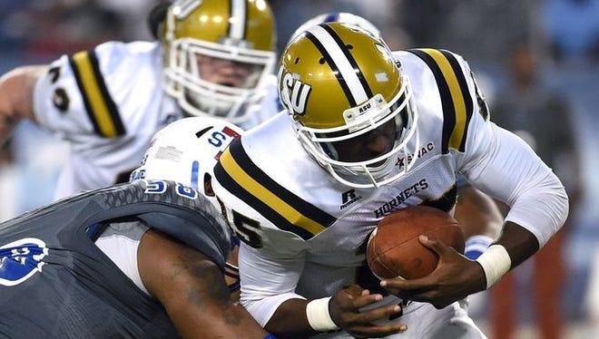 Tennessee State's Latrelle Lee sacks Alabama State quarterback Daniel Duhart during Sunday's game in Nashville.