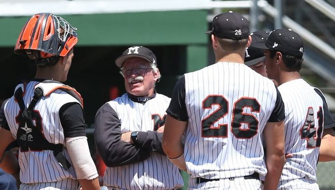 Mamaroneck baseball coach Mike Chiapparelli speaks to his team during a Class AA quarterfinal against North Rockland on May 23, 2015.