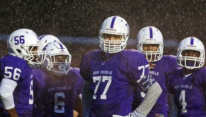 In a game played through heavy rain, New Rochelle defeated Clarkstown North 12-6 in a varsity football game at New Rochelle Oct. 2, 2015.