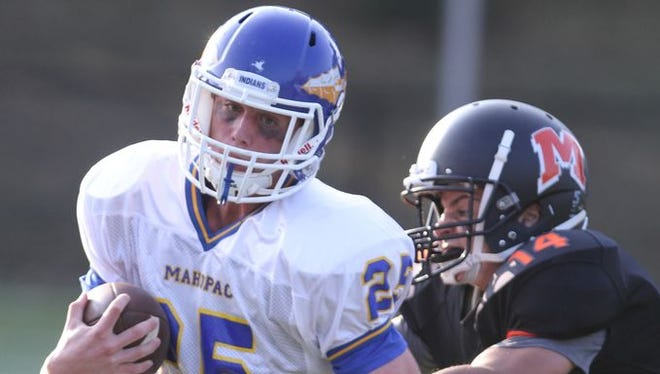 Mahopac's Christian Donahoe runs the ball during a game at Mamaroneck High School on Sept. 4, 2015.