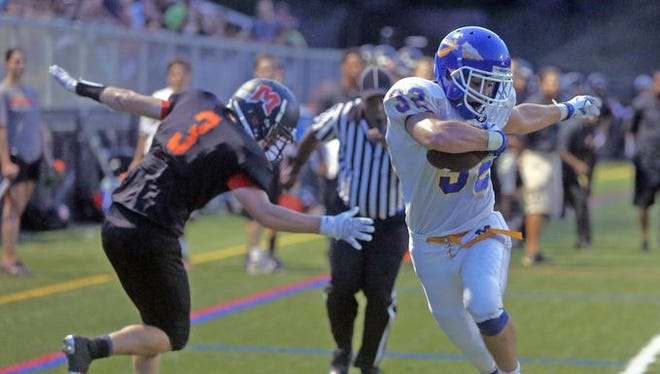 Mahopac's Joe Cavaciuti steps out of bounds at the four yard line while being defended by Mamaroneck's Stuart Williamson in the fourth quarter of a varsity football game at Mamaroneck High School Sept. 4, 2015. Cavacuiti scored Mahopac's first touchdown several plays later. Mahopac defeated Mamaroneck 21-7.