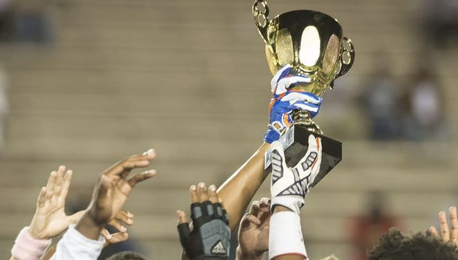 Park Crossing celebrates winning the Crosstown Showdown over G.W. Carver on Friday night at Cramton Bowl.
