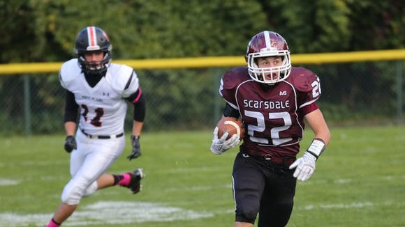 Scarsdale's Nick Leone runs the ball in front of White