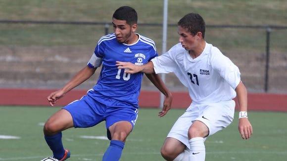 Port Chester's Steven Hernandez moves the ball in front