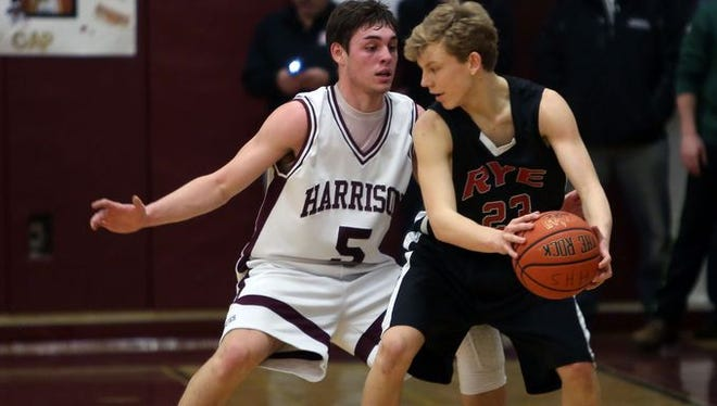 Rye's Charlie Nagle holds the ball during his team's Class A playoff game at Harrison High School Feb. 12, 2015. Nagle is this week's Varsity Insider Player of the Week.