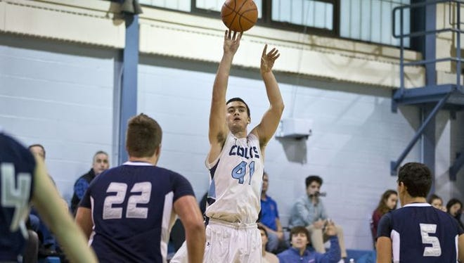 CBA senior forward Pat Andree takes a three-pointer, which he made to become the school's all-time leading scorer on Jan. 19. He finished with 26 points that night to have 1,674 for his career