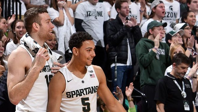 Matt Costello and Bryn Forbes enjoy the closing moments of MSU's win.