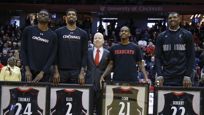 UC seniors (L-R) Shaq Thomas, Octavius Ellis, Farad Cobb and Coreontae DeBerry, with coach Mick Cronin.