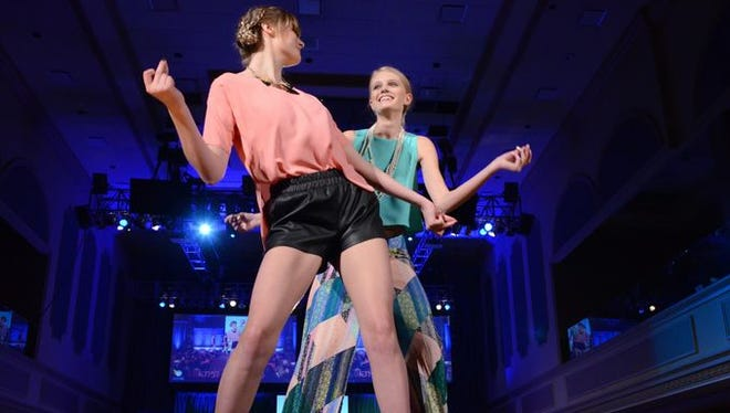 Models dancing at the 2015 KDF Fashion Show.