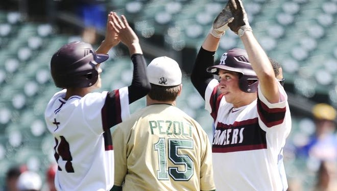Riverview Gabriel Richard's Jake Lipetzky greets Shawn Szpaichler at home after taking the lead in the 5th inning.