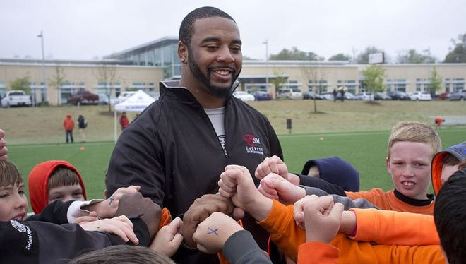 Tajh Boyd greets youngsters during his football camp in Greenville in 2015.