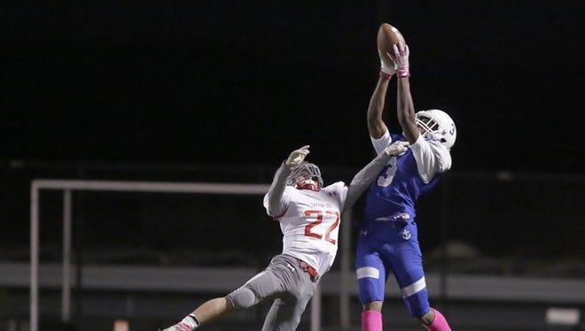 Hen Hud's Marquan Anderson catches a long pass from Nick Cunningham early in his team's 20-14 win over visiting Tappan Zee on Oct. 14, 2016.
