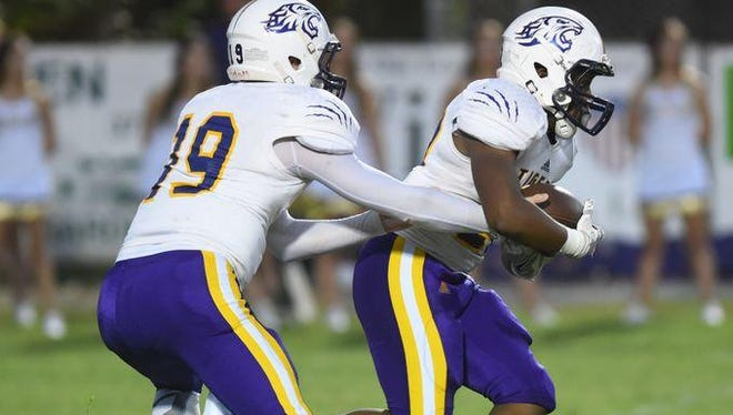 Benton quarterback Garrett Hable (left) and Jermaine Newton Jr. (right) had big nights in a first-round playoff games against Ellender on Friday.