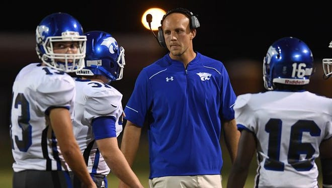 Ned Cuthbertson, center, has resigned after three seasons as Woodmont High School's football coach.