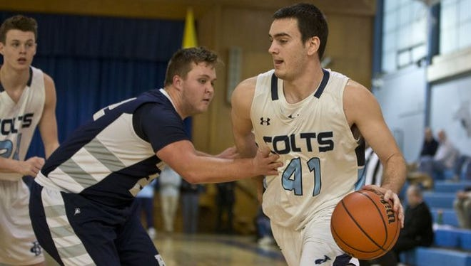 Former CBA star Pat Andree (41) dribbles to the basket on the day, Feb. 19, 2016, he became the school's all-time leading scorer