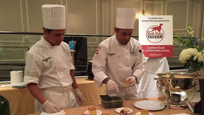 Marvin Argueneta (left) and Sous chef Adan Bafarano of GK's Red Dog Tavern in Madison serve up savory chicken pot pies.