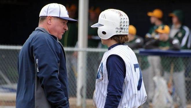 Adena baseball coach Tom Barr talks with outfielder Hayden Henness during a Division III sectional final against North Adams last season.