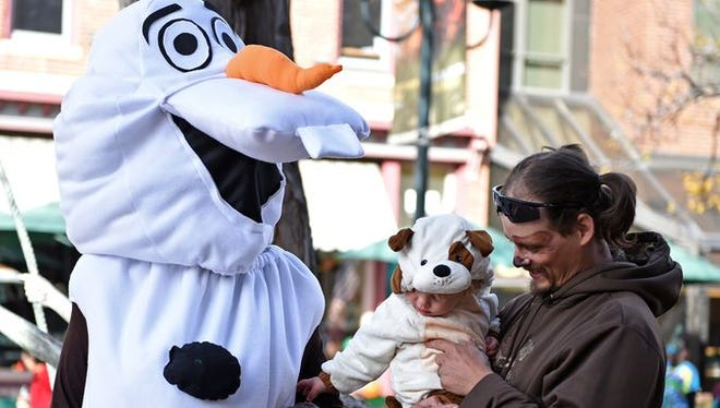 Children of all ages enjoy the Tiny Tots Halloween trick-or-treating event in downtown Fort Collins Friday, Oct. 31, 2014.