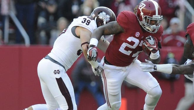 Derrick Henry scored on a short touchdown run in Alabama's 25-20 win over Mississippi State.