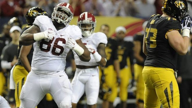 Alabama defensive lineman A'Shawn Robinson (86) celebrates a stop against Missouri at the SEC Championship Game in the Georgia Dome in Atlanta, Ga.