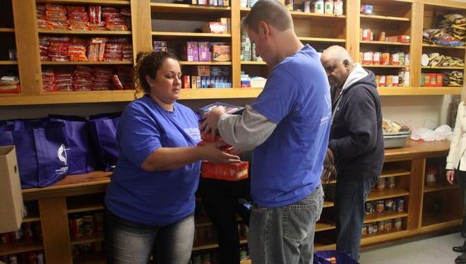 Volunteers sort donations at the Aldersgate Crisis Room, Tuesday, November 25, 2014, in East Brunswick, NJ. Jason Towlen/Staff Photographer   Jason Towlen/Staff Photographer