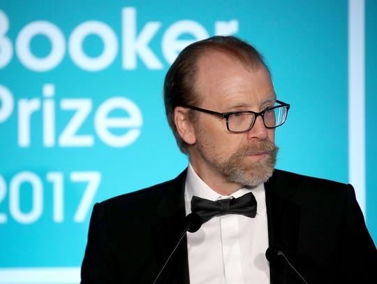 Winning author George Saunders on stage at the Man