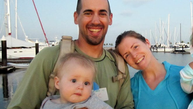 Eric and Charlotte Kaufman with their daughter, Lyra, 1.