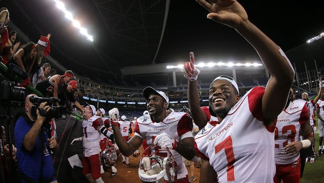 MIAMI, FL - DECEMBER 21:  Joe Brown #7 of the Western Kentucky Hilltoppers celebrates winning the 2015 Miami Beach Bowl against the South Florida Bulls at Marlins Park on December 21, 2015 in Miami, Florida.  (Photo by Mike Ehrmann/Getty Images)