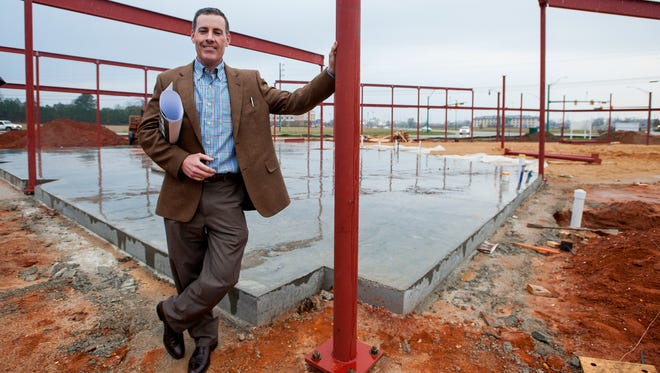 Breck Honea, of Honea Insurance and Financial Services, poses at the future site of EastChase Plaza on EastChase Blvd. on Wednesday January 20, 2015. Honea is building the shopping center to house his business as well as others.
