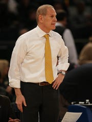 Michigan head coach John Beilein on the bench during