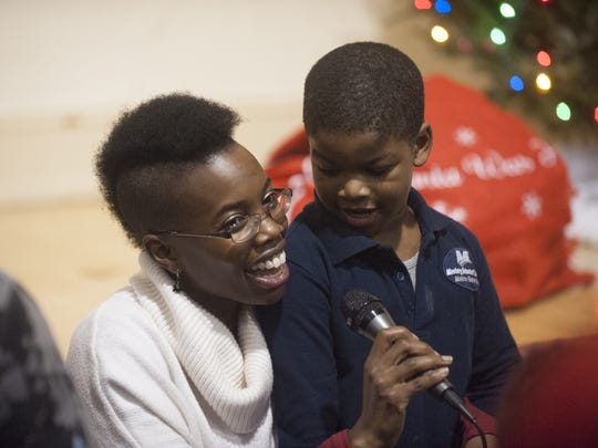 Vedra Chandler sings Christmas songs with Christopher McMillan at the Neighborhood Center in Camden. The Center is partnering with the Ritz for a 'buy a ticket gift a ticket' program for teens at the Neighborhood Center in Camden to see a performance of 'Memphis' in January.
